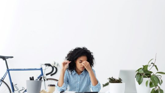 young woman at work feeling stress